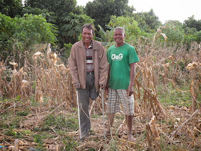 Photo: Pen Sarin with landmine survivor Project Coordinator Nil Noy. Sarin is homeless. New Home provided by CLMF