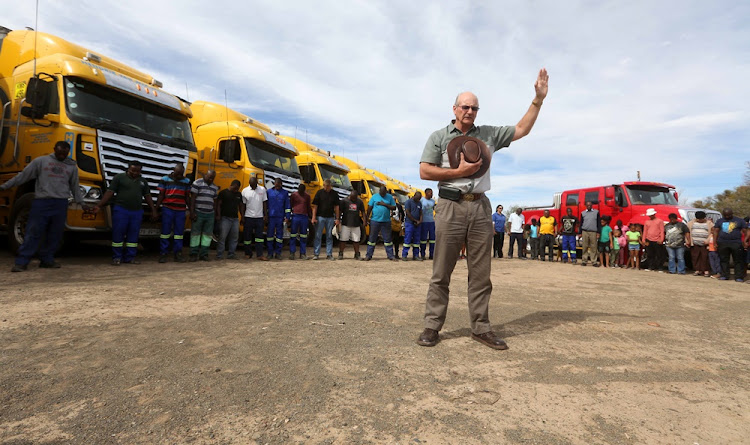 Farmer Anton Smit appeals to a higher power for  rain with drivers at a  Beaufort West truck stop on November 08, 2017.