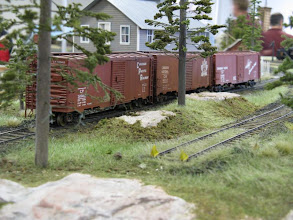 Photo: A cut of boxcars wait to be unloaded at Muskoka siding.