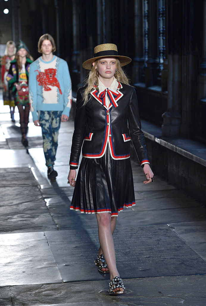 A model in a boater hat during the Gucci Cruise 2017 fashion show at the Cloisters of Westminster Abbey in London, in June 2016