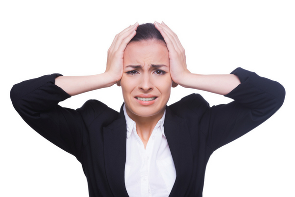 Woman with hands on her head looking worried