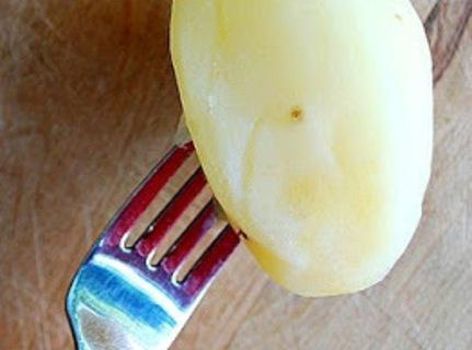 After they've boiled for 10 minutes , take a potato out of the pot...