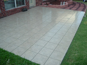 Photo: Outdoor patio floor installation in 12x12 ceramic tile.