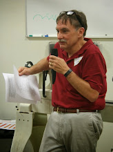 Photo: President Tim Aley goes through a multi-page Meeting Agenda.