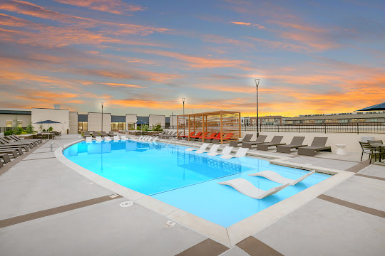 Adley City Springs upscale sparkling pool at dusk