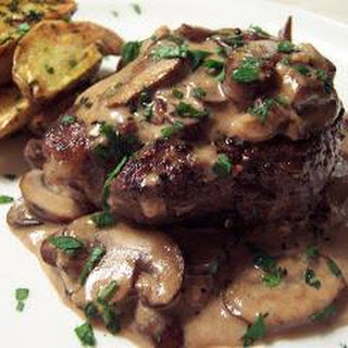 Beef Tenderloin with mushroom Brandy Cream Sauce $Roasted Truffled Fingerling Potatoes.