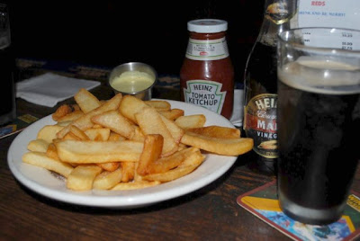 This is a photo of a plate of pub chips (french fries) with a side of curry mayonaise.