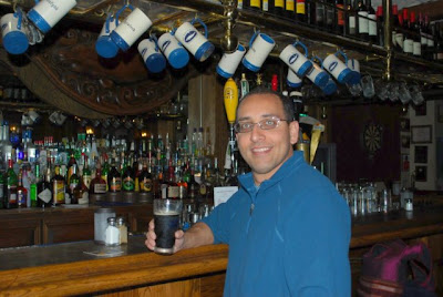 This is a photo of Anand Kolatkar at the Whale and Ale Pub in Port San Pedro, CA enjoying a cold pint of Guiness.
