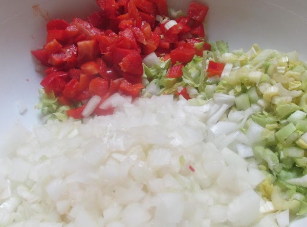Chop celery, bell pepper, onions and mince garlic.