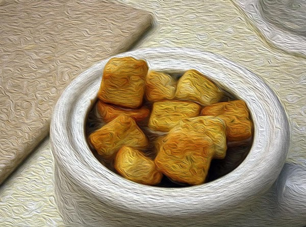 Place a generous helping of the toasted bread cubes on top of each bowl...