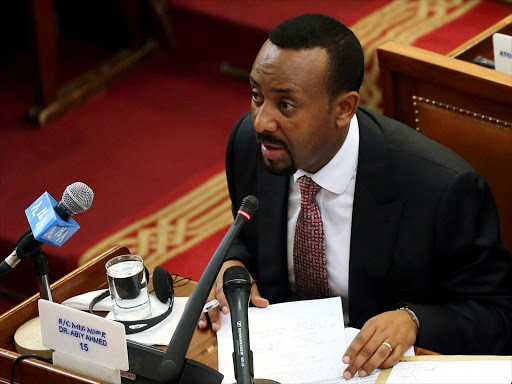 Ethiopia'sPrime Minister Abiy Ahmed addresses the members of parliament inside the House of Peoples' Representatives in Addis Ababa, Ethiopia April 19, 2018. /REUTERS