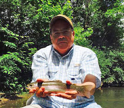 Photo: Extremely big tipper here! Mike Jines from Houston, Texas with a surprise Mad River rainbow.