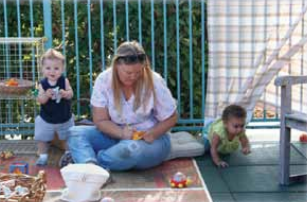 A caregiver taking notes on observed behavior of infants and toddlers