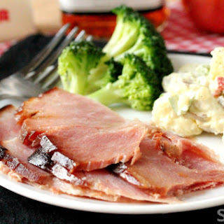Slow Cooker Hot Buttered Bourbon And Apple Cider Ham.