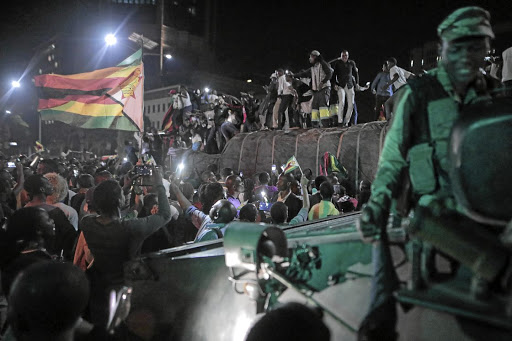 Jubilation: Zimbabweans celebrate the resignation of Robert Mugabe