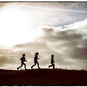 Running Silhouette by Corine de Ruiter - People Family ( contrast, shadow, family, silhouette, children, light,  )