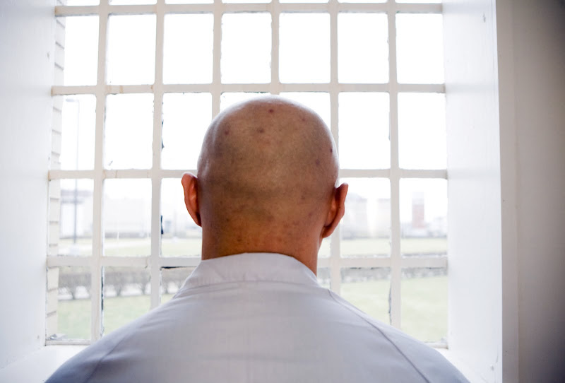 Andrew Suh looks out through the barred windows of the Pontiac Correctional Facility in Iris Shim's HOUSE OF SUH