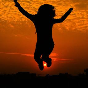 Leap Of Freedom by Naveen Rai - People Fine Art ( pwcsilhouettemotion, silhouette, twilight, dusk, people, , Free, Freedom, Inspire, Inspiring, Inspirational, Emotion )