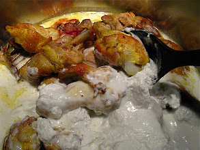Photo: browned chicken in pot with coconut milk