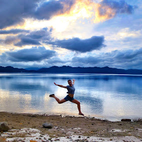 Leaping for lake Tazawako by Allanah Faherty - Landscapes Waterscapes ( japan, sunset, tazawako, lake, people, jump )