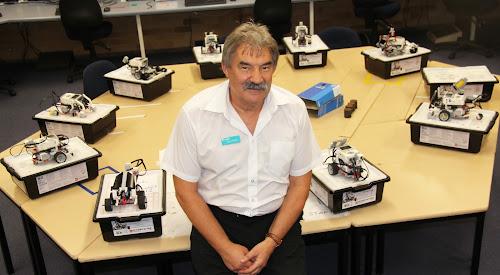 Richard Baranski at Narrabri Tafe with some of his younger students' robotic creations.