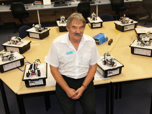 Richard Baranski at Narrabri Tafe with some of his younger students' robotic creations.