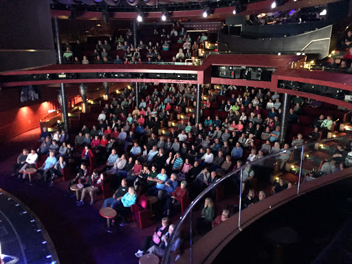 theater-audience-oosterdam.jpg - Theatergoers enjoying a BBC Earth production during a sailing on ms Oosterdam.
