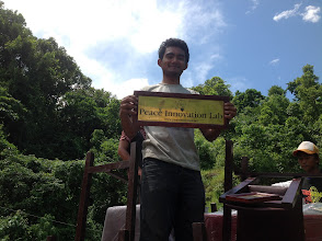 Photo: Shrijan Amatya, a high school graduate and a member of PIL's Leadership, showing the PIL brass plate. Shirjan is traveling to London later this year to attend British Council's Global Youth Summit.