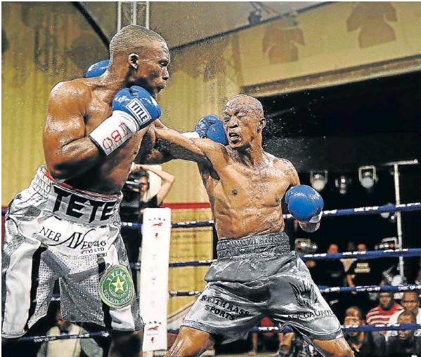 TAKE THAT: Makazole Tete, left, and Gideon Buthelezi exchange jabs in their fight at the Orient Theatre recently. Buthelezi will face Argentinean Lucas Emanuel Fernandez Leone this month.