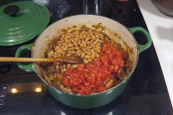 Add the tomatoes, and kidney beans (beans are optional).