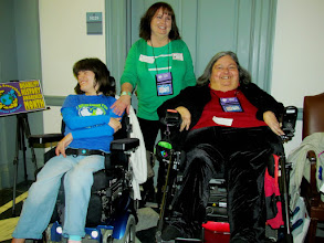 Photo: Brigitte Hancharick, Terri Hancharick and Jamie Wolfe pause for a photo during Disability Day at Legislative Hall on 3.25.15.