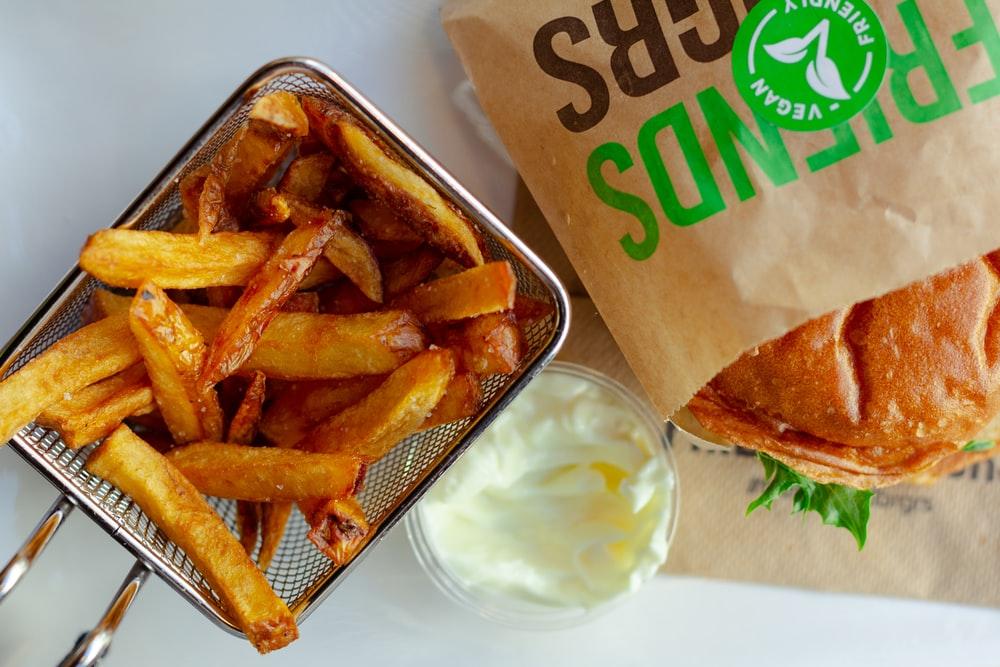 fried fries and sliced lemon on white ceramic plate