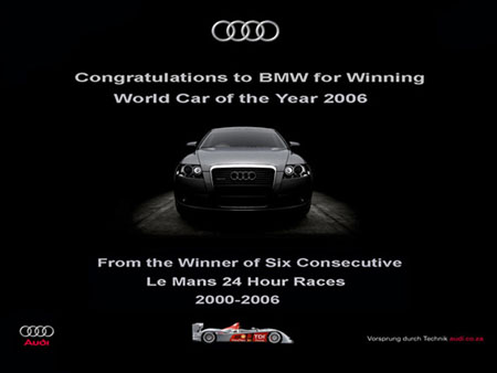 Audi advertisement - Congratulation to BMW For World Car of the Year 2006 - From the Winner of Six Consecutive Le Mans 24 Hour Races 2000-2006