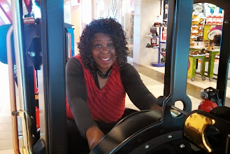 Photo: My beautiful mother playing on a kiddie train. Only mommy!