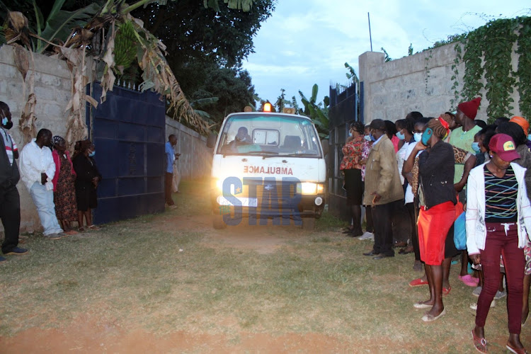 An ambulance carrying bodies of four family members killed at Karuri village, Kiambaa, Kiambu County leaves the scene on January 6, 2020.