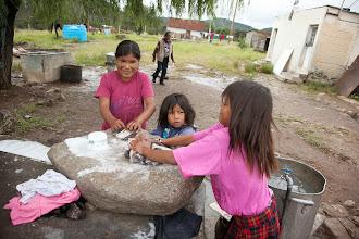 Photo: Kids washing their own clothes