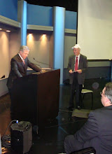 Photo: KNX Business Hour Host Frank Mottek reads the honors and gifts handed to Stan Chambers at RTNA night. Sitting in Foreground is Andy Ludlum, program director, KNX/KFWB News/Talk.