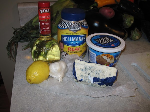Mix everything (except blue cheese)together with an electric beater.  Stir in crumbled blue...