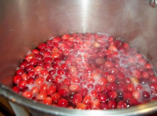 Combine water and cranberries in a large pot. Bring to a boil. Reduce heat...