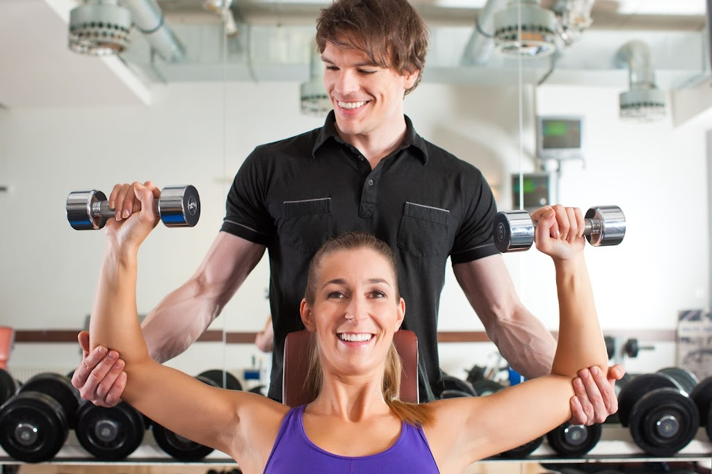 Woman working with a trainer at Iron-Oak Fitness
