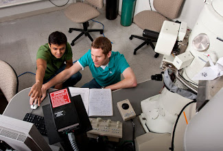 Photo: Anmiv and Kevin are fabricating solid-state nanopores using transmission electron microscope. Photo taken by Evan Rosen