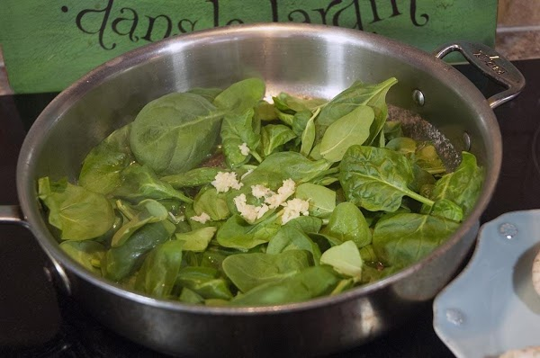 Add the spinach and the minced garlic to the sauté pan.