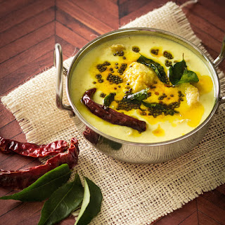 Ethappazham Pulissery - Ripe Plantain Curry in Yogurt and Coconut Sauce