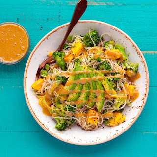 Peanut-Broccoli Rice Noodle Bowl with Avocado and Mango.