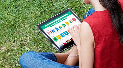 Photo of a person using a tablet.