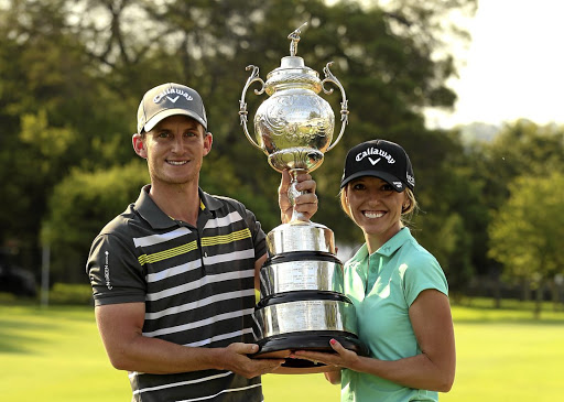 Power pair: Chris Paisley gets a little help holding the winner's trophy from his wife, Keri, who caddied for him at the SA Open. Picture: LUKE WALKER/SUNSHINE TOUR/GALLO IMAGES