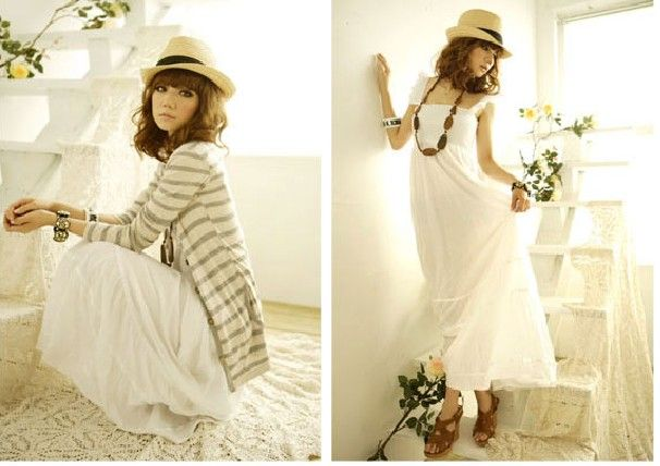 Модное длинное платье белого цвета.