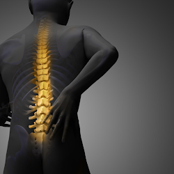 image of man touching lower back with pain area