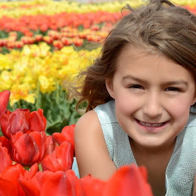 Brooklyn in the tulip field. by Marie Burns - Babies & Children Child Portraits ( child, girl, tulips, flowers, spring )