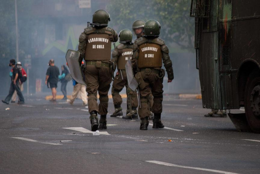 Riot police at a protest in Chile
